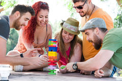 Friends playing block game Royalty Free Stock Photography