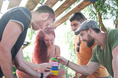 Friends playing block game Stock Image