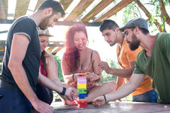 Friends playing block game Royalty Free Stock Photo