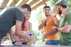 Friends playing block game stock images