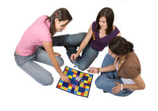 Friends playing board games Stock Photos