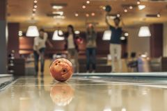Friends playing bowling Stock Images
