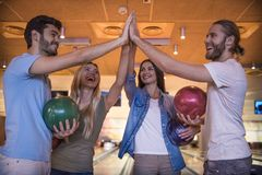 Friends playing bowling Stock Photography