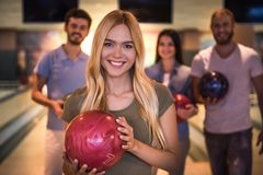 Friends playing bowling Royalty Free Stock Photo