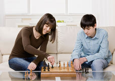 Friends playing chess Stock Photography