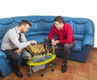 Friends Playing Chess Royalty Free Stock Photos