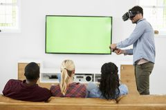 Friends Playing Computer Game With Virtual Reality Headset Stock Image