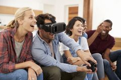 Friends Playing Computer Game With Virtual Reality Headset Royalty Free Stock Images