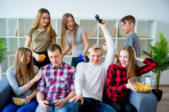 Friends playing a console game Stock Photography
