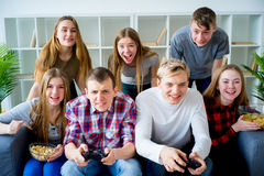 Friends playing a console game. Group of friends playing a console game Royalty Free Stock Photo