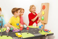 Friends playing drivers at road safety class royalty free stock photo