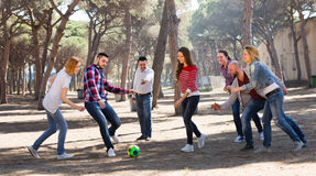 Friends playing football Royalty Free Stock Photos