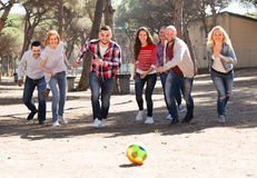 Friends playing football Stock Photos