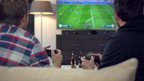Friends playing football on video game console