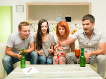 Friends playing game with dices Royalty Free Stock Photo