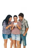 Friends playing game phone Royalty Free Stock Photos