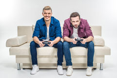 Friends playing with joysticks Royalty Free Stock Photo