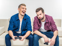 Friends playing with joysticks Stock Image