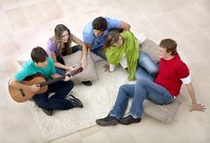 Friends playing music and singing Stock Image