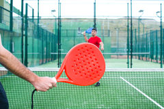 Friends playing paddle tennis. Stock Photography