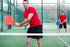 Friends playing paddle tennis. Royalty Free Stock Images