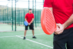 Friends playing paddle tennis. Royalty Free Stock Photo
