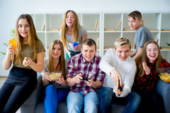 Friends playing playstation Stock Photo