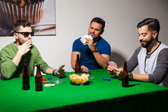 Friends playing poker at home Royalty Free Stock Image