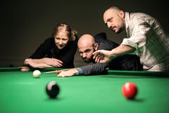 Friends playing pool stock photography