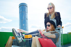 Friends playing with shopping cart Stock Photos