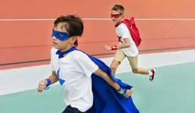 Friends playing superheroes together. Running Royalty Free Stock Images