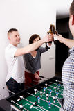 Friends playing table football. Stock Images