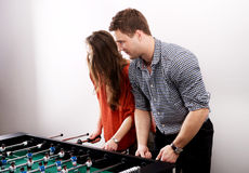 Friends playing table football. Stock Photo