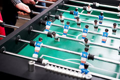 Friends playing table football. Royalty Free Stock Image