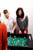 Friends playing table football. Royalty Free Stock Photos