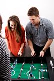 Friends playing table football. Royalty Free Stock Photography