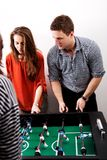 Friends playing table football. Stock Photos