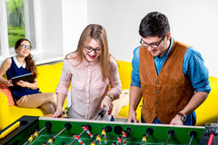 Friends playing table football Royalty Free Stock Photos