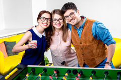 Friends playing table football Stock Photography