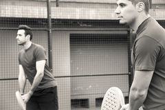 Friends playing team  paddle tennis. Royalty Free Stock Photos