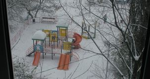 Friends playing together at playground in winter stock footage