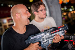 Friends playing with a toy shotgun Stock Photo