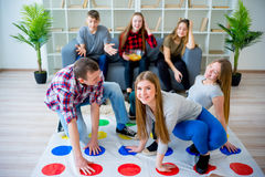 Friends playing twister Royalty Free Stock Image