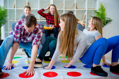 Friends playing twister Stock Images