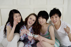 Friends playing video game Stock Image