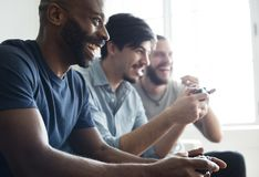 Friends playing video game together Stock Photos