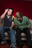 Friends playing video games Royalty Free Stock Photography