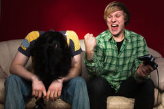 Friends playing video games Royalty Free Stock Photos