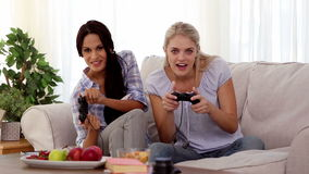 Friends playing video games together. At home on the couch stock video