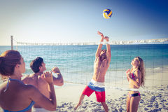 Friends playing volleyball Royalty Free Stock Images
